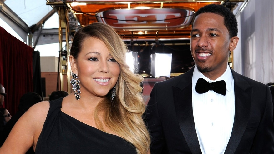 LOS ANGELES, CA - JANUARY 18:  Singer-actress Mariah Carey and TV personality Nick Cannon attend the 20th Annual Screen Actors Guild Awards at The Shrine Auditorium on January 18, 2014 in Los Angeles, California.  (Photo by Kevork Djansezian/Getty Images)
