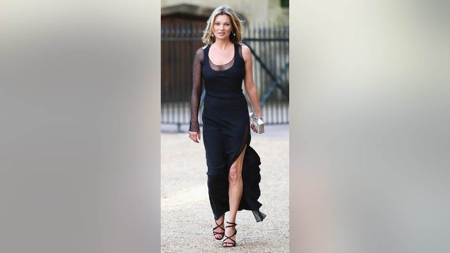 Model Kate Moss arrives for a dinner to celebrate the work of The Royal Marsden hosted by Britain Prince William at Windsor Castle, in Windsor, May 13, 2014.  REUTERS/Chris Jackson/Pool  (BRITAIN - Tags: ROYALS ENTERTAINMENT FASHION) - RTR3P05M