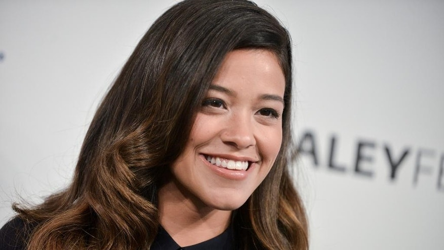 "FILE - In this Sept. 6, 2014 file photo, actress Gina Rodriguez arrives at the 2014 PALEYFEST Fall TV Previews - The CW in Beverly Hills, Calif.  Rodriguez portrays Jane in The CW series, ""Jane The Virgin,"" premiering Monday, Oct. 13, 2014. (Photo by Richard Shotwell/Invision/AP)"