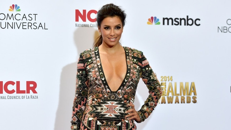 PASADENA, CA - OCTOBER 10:  Host Eva Longoria attends the Winner's Walk during the 2014 NCLR ALMA Awards at the Pasadena Civic Auditorium on October 10, 2014 in Pasadena, California.  (Photo by Alberto E. Rodriguez/Getty Images for NCLR)