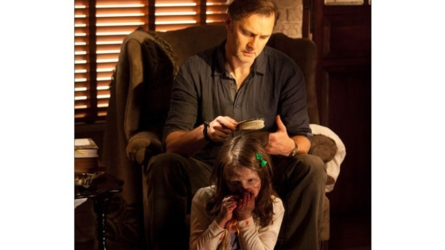 "This undated image released by AMC shows David Morrisey as The Governor brushing the hair of Kylie Szymanski as Penny in a scene from the third season of ""The Walking Dead."""