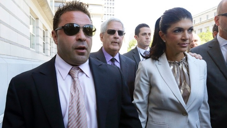 "Giuseppe ""Joe"" Giudice, 43, left, and his wife, Teresa Giudice, 41, of Montville Township, N.J., walk out of Martin Luther King, Jr. Courthouse after a court appearance, Tuesday, July 30, 2013, in Newark, N.J."