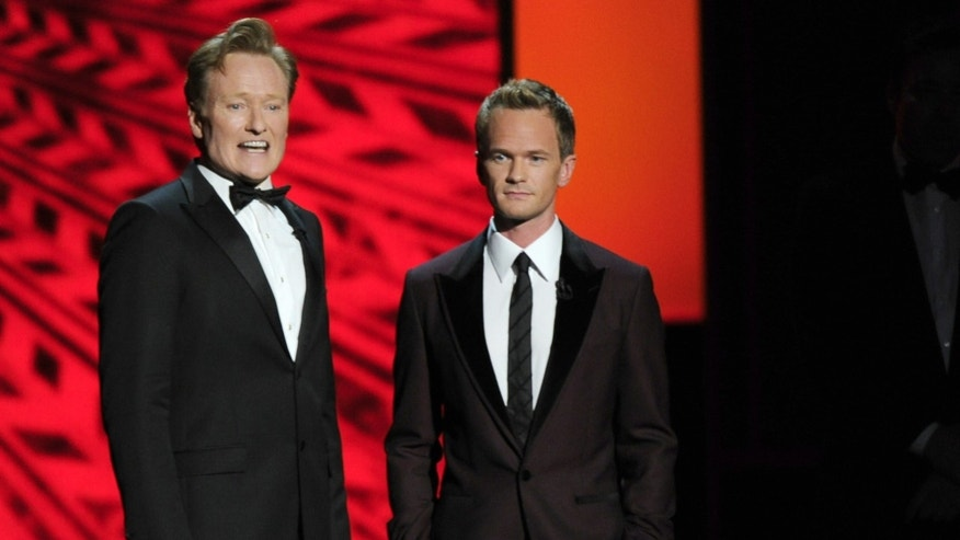Conan O'Brien, left, and Neil Patrick Harris appear on stage at the 65th Primetime Emmy Awards at Nokia Theatre on Sunday Sept. 22, 2013, in Los Angeles.