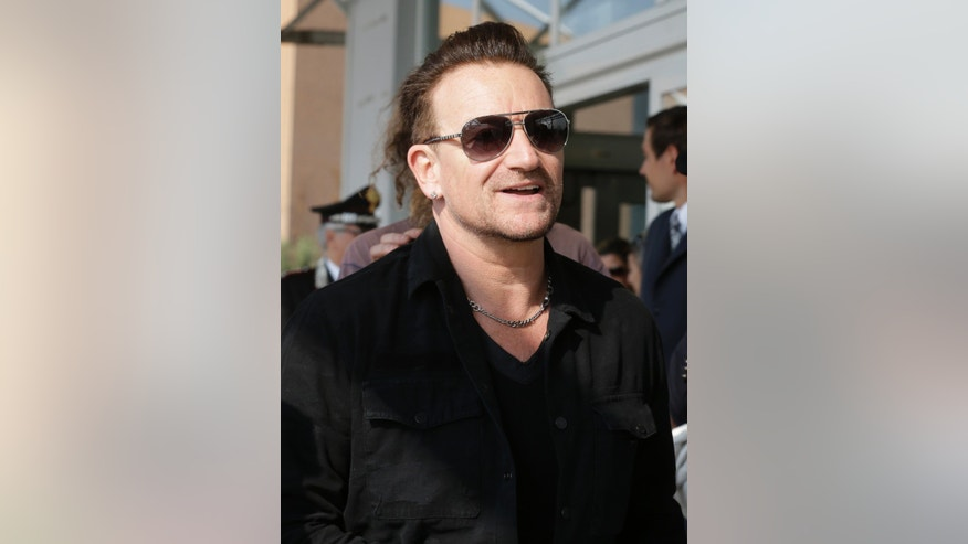 Sept. 27, 2014. Bono smiles upon his arrival in Venice, Italy, to attend George Clooney's wedding ceremony.