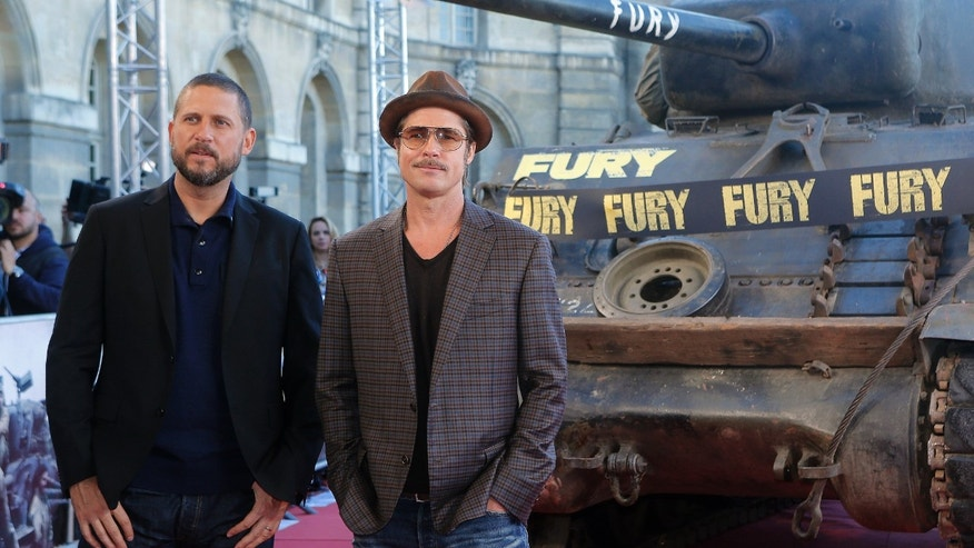"October 18, 2014. Brad Pitt, right, and director David Ayer pose for photographers during the photocall of ""Fury"" in Paris."
