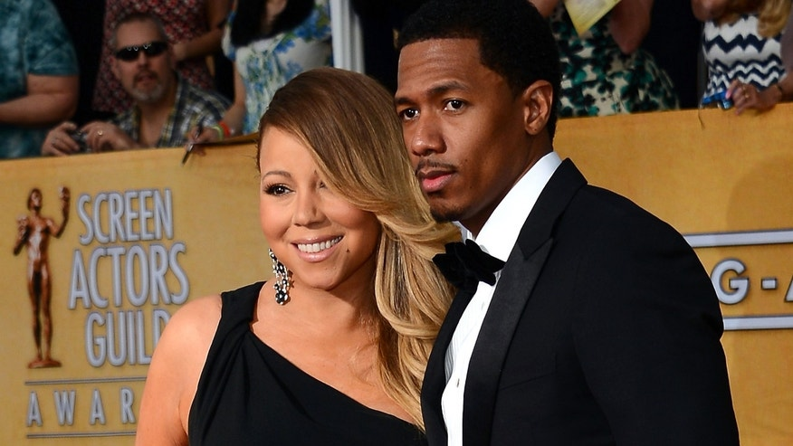 Singer Mariah Carey and her soon to be ex husband Nick Cannon, on January 18, 2014.