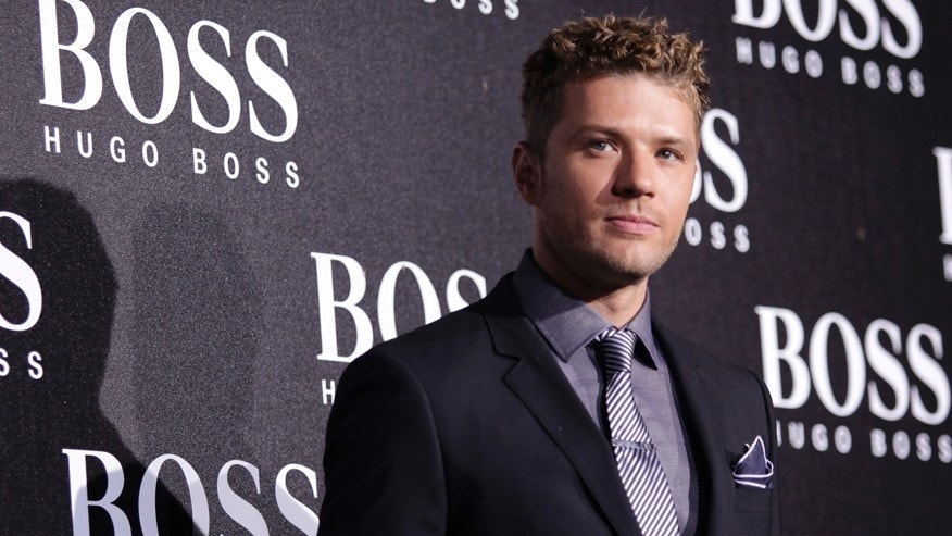 U.S. actor Ryan Phillippe poses ahead of the BOSS Black fall/winter 2012 fashion show by Hugo Boss in Beijing, May 18, 2012. REUTERS/Soo Hoo Zheyang (CHINA - Tags: ENTERTAINMENT FASHION) - RTR3294A