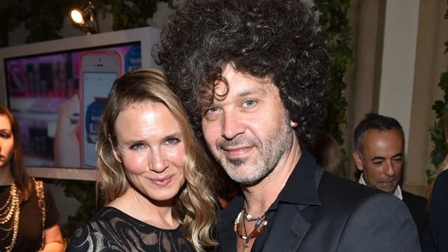 Renee Zellweger, left, and Doyle Bramhall II attend ELLE's 21st annual Women In Hollywood Awards at the Four Seasons Hotel on Monday, Oct. 20, 2014, in Los Angeles. (Photo by John Shearer/Invision/AP)