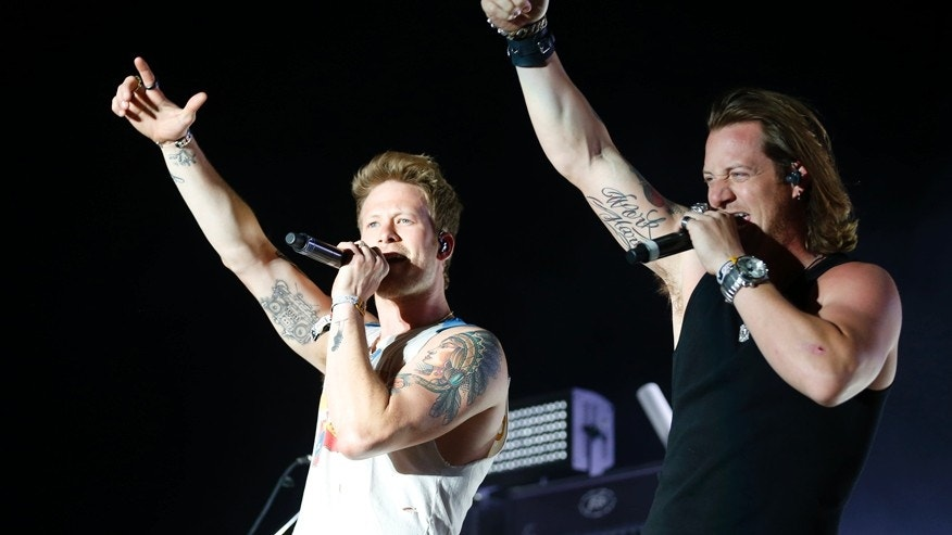 Brian Kelley (L) and Tyler Hubbard of the country pop group Florida Georgia Line made $24 million.