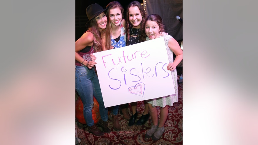 From left: Rebecca Robertson, Sadie Robertson, Mary Kate McEacharn and Bella Robertson celebrate the newest member of the Robertson clan.