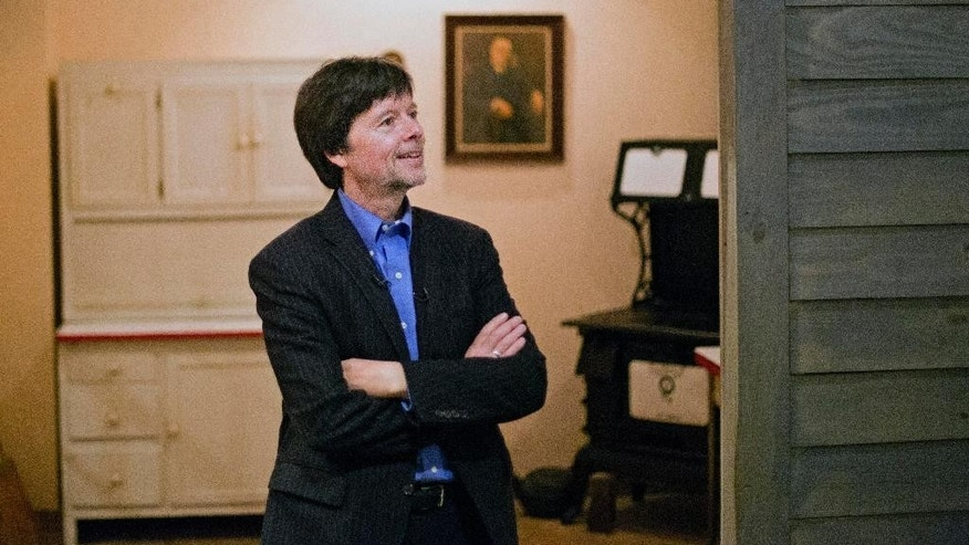 "FILE - In this Nov. 2, 2013 file photo, documentary filmmaker Ken Burns walks through the museum at the Georgia home used by former President Franklin D. Roosevelt in Warm Springs, Ga.  FDR, first lady Eleanor Roosevelt and another Roosevelt who occupied the White House as president, Theodore Roosevelt, are the subjects of a new Burns documentary for public television, ""The Roosevelts: An Intimate History."" PBS said the seven, two-hour episodes that aired last month had an average audience of 9.2 million viewers. The most popular was the first night, on Sept. 14, which had 11.7 million viewers, according to the Nielsen company. (AP Photo/David Goldman, File)"