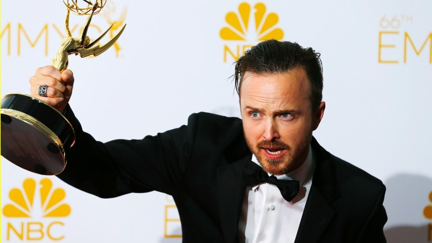 "August 25, 2014. Aaron Paul poses with his Outstanding Supporting Actor in a Drama Series for ""Breaking Bad"" at the 66th Primetime Emmy Awards in Los Angeles."