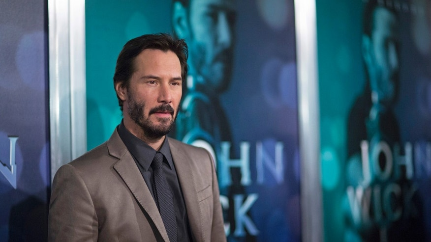 "October 22, 2014. Cast member Keanu Reeves poses at a special screening of  ""John Wick"" in Los Angeles, California."