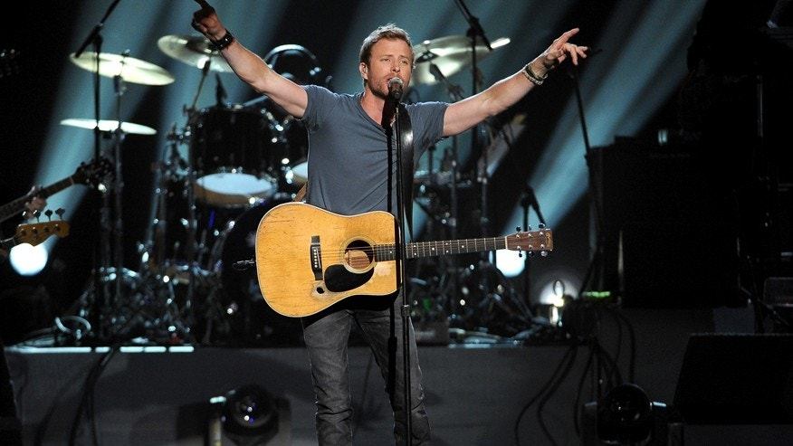 In this April 7, 2014 file photo, country singer Dierks Bentley performs at ACM Presents an All-Star Salute to the Troops in Las Vegas. Bentley, Brad Paisley and Luke Bryan will perform in a three-day country music festival in New York next summer.