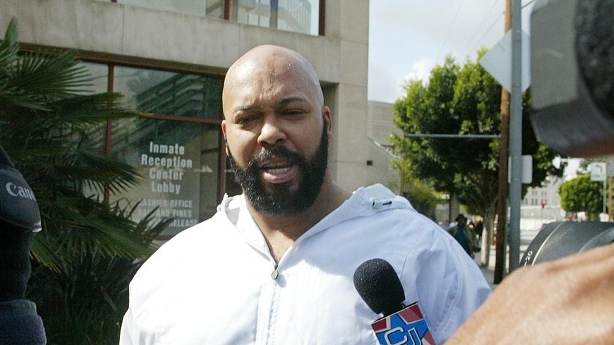 "FIL: Rap music mogul Marion ""Suge' Knight walks out of the Los Angeles County jail, in Los Angeles."