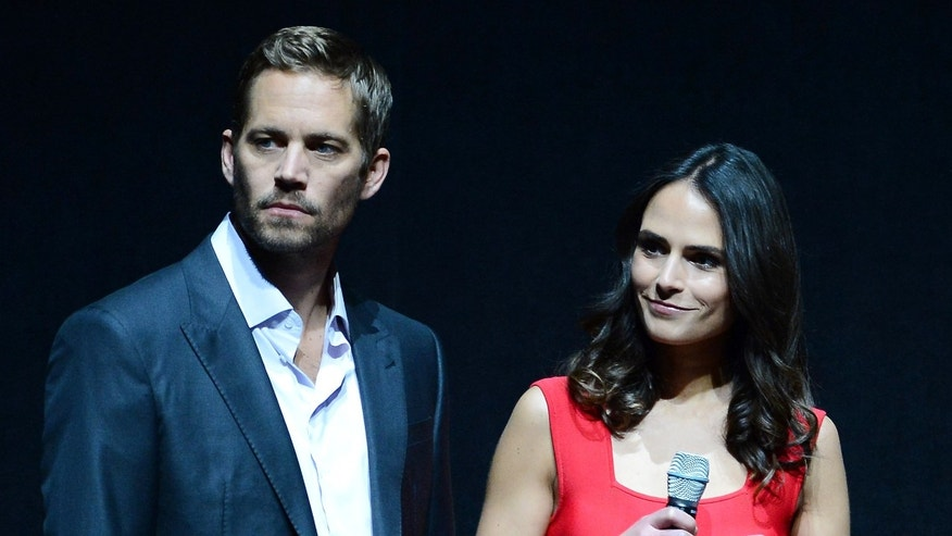 "LAS VEGAS, NV - APRIL 16:  Actor Paul Walker (L) and actress Jordana Brewster attend a Universal Pictures presentation to promote their upcoming film ""Fast & Furious 6"" at The Colosseum at Caesars Palace during CinemaCon, the official convention of the National Association of Theatre Owners, on April 16, 2013 in Las Vegas, Nevada.  (Photo by Ethan Miller/Getty Images)"