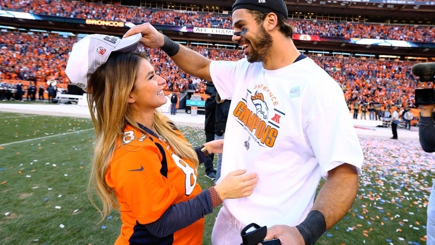 Jan 19, 2014; Denver, CO, USA; Denver Broncos wide receiver Eric Decker (right) celebrates with pregnant wife Jessie James following the game against the New England Patriots during the 2013 AFC Championship football game at Sports Authority Field at Mile High. The Broncos defeated the Patriots 26-16. Mandatory Credit: Mark J. Rebilas-USA TODAY Sports - RTX17LUB