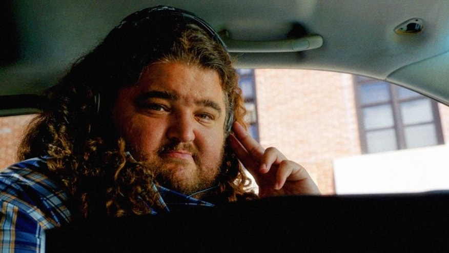"This screen grab photo provided by CBS shows Jorge Garcia as Jerry Ortega in a scene from season 5 of the television series, ""Hawaii Five O,"" Friday, Oct. 10, 2014, (9:00-10:00, ET/PT), on the CBS Television Network. Garcia is back in Hawaii and liking it with his increased role on ""Hawaii Five-O."" (AP Photo/CBS)"
