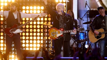 Randy Bachman (C) and Bachman-Turner Overdrive perform with the Sheepdogs at the 2014 Juno Awards in Winnipeg March 30, 2014. REUTERS/Trevor Hagan (CANADA - Tags: ENTERTAINMENT) - RTR3J93K