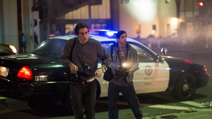"Jake Gyllenhaal, left, and Riz Ahmed appear in a scene from the film, ""Nightcrawler."""