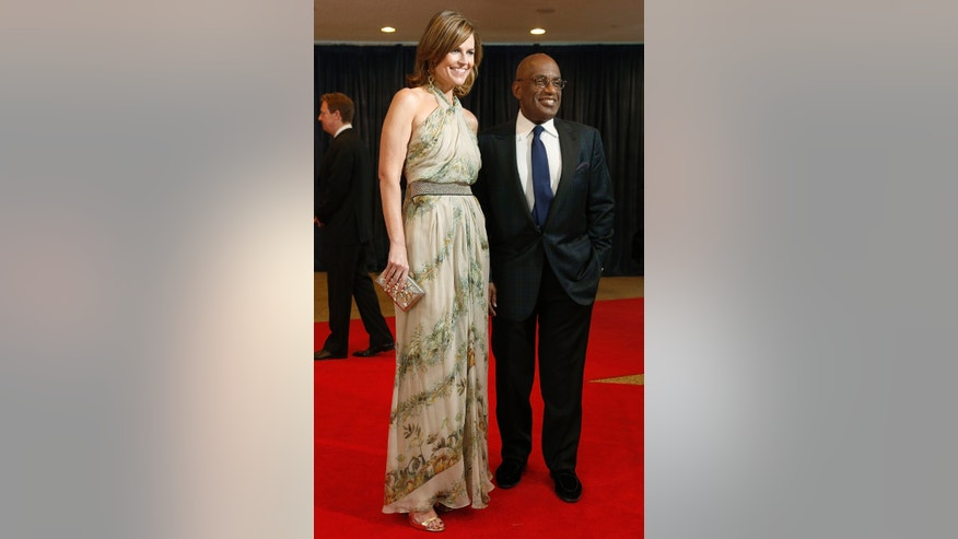 "April 27, 2013. Television hosts Savannah Guthrie (L) and Al Roker of the ""Today"" show arrive on the red carpet at the annual White House Correspondents Association dinner in Washington."