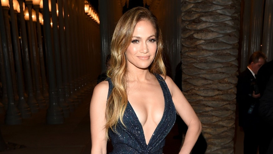 LOS ANGELES, CA - NOVEMBER 01:  Actress/singer Jennifer Lopez, wearing Gucci, attends the 2014 LACMA Art + Film Gala honoring Barbara Kruger and Quentin Tarantino presented by Gucci at LACMA on November 1, 2014 in Los Angeles, California.  (Photo by Jason Merritt/Getty Images for LACMA)