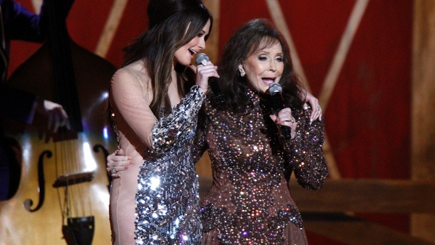 Kacey Musgraves, left, and Loretta Lynn perform onstage at the 48th annual CMA Awards at the Bridgestone Arena on Wednesday, Nov. 5, 2014, in Nashville, Tenn.