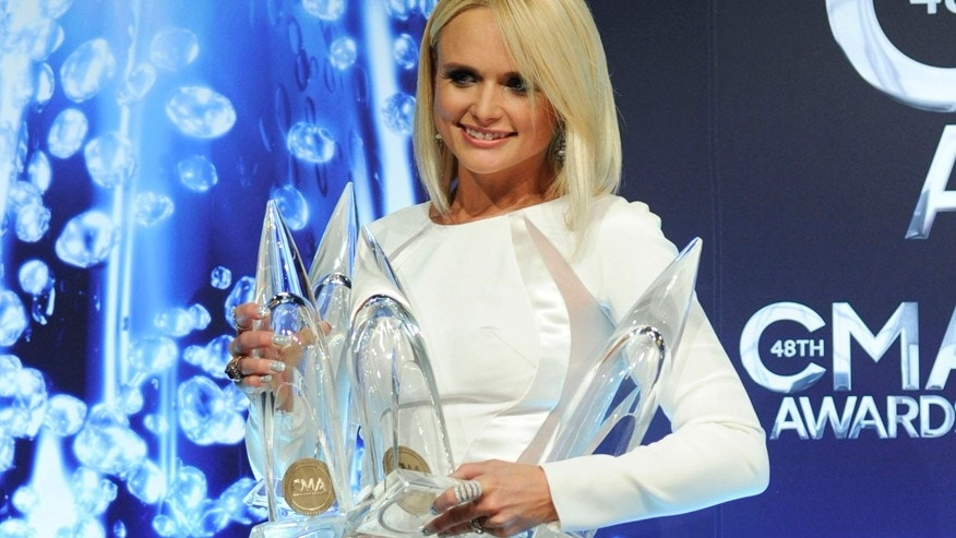 Miranda Lambert, winner of the awards for album of the year, female vocalist of the year, single of the year and musical event of the year, poses in the press room at the 48th annual CMA Awards at the Bridgestone Arena on Wednesday, Nov. 5, 2014, in Nashville, Tenn.