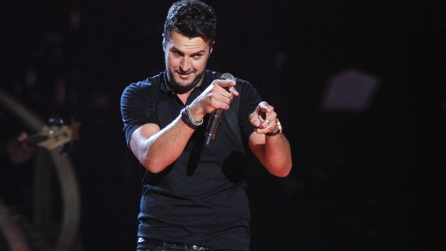 November 5, 2014: Luke Bryan performs onstage at the 48th annual CMA Awards at the Bridgestone Arena in Nashville, Tenn. (Photo by Wade Payne/Invision/AP)
