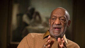 "This photo taken Nov. 6, 2014 shows entertainer Bill Cosby gesturing during an interview about the upcoming exhibit, Conversations: African and African-American Artworks in Dialogue, at the Smithsonian's National Museum of African Art in Washington. The Smithsonian Institution is mounting a major showcase of African-American art and African art together in a new exhibit featuring the extensive art collection of Bill and Camille Cosby. More than 60 rarely seen African-American artworks from the Cosby collection will join 100 pieces of African art at the National Museum of African Art. The exhibit ""Conversations: African and African American Artworks in Dialogue,"" opens Sunday and will be on view through early 2016. (AP Photo/Evan Vucci)"