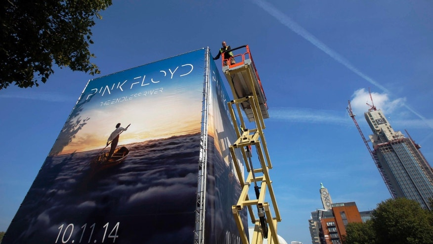 "Advertising for the new Pink Floyd album ""The Endless River"" is installed on a four sided billboard on the South Bank in London September 22, 2014. The album cover was designed by 18 year old Egyptian digital artist Ahmed Emad Eldin and the album is released on November 10, 2014. REUTERS/Luke MacGregor (BRITAIN - Tags: ENTERTAINMENT) - RTR479KW"