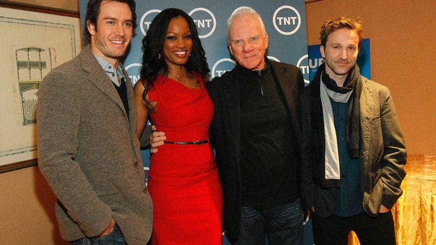 "Cast members (from L-R) Mark-Paul Gosselaar, Garcelle Beauvais, Malcolm McDowell and Breckin Meyer from the television series ""Franklin & Bash"" pose during the Turner Broadcasting Television Critics Association winter press tour in Pasadena, California January 6, 2011."