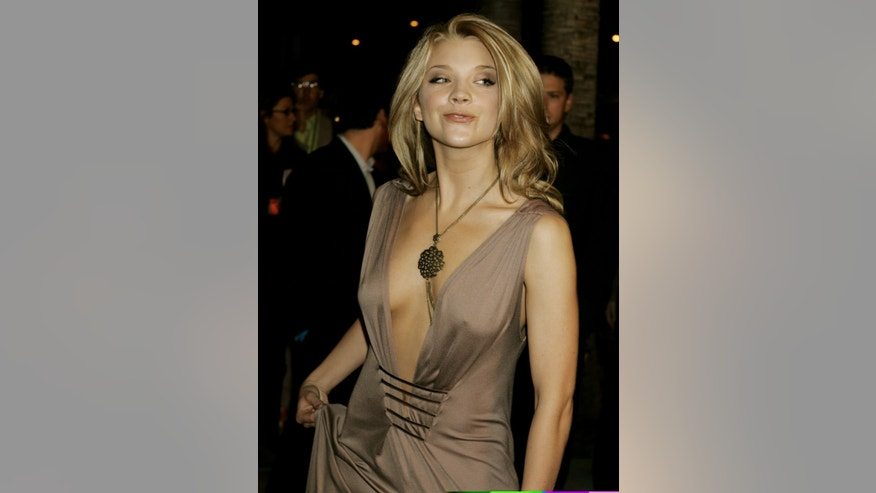 Actress Natalie Dormer, one of the stars of the new film 'Casanova' poses as she arrives for the film's North American premiere at the AFI Fest 2005 in Hollywood November 13, 2005. The film directed by Lasse Hallstrom, also stars Heath Ledger, Lena Olin, Sienna Miller and Oliver Platt and opens December 25 in the United States. REUTERS/Fred Prouser - RTR1AXPF