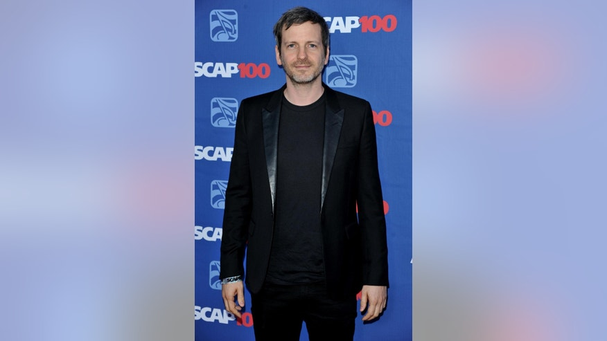 FILE - In this April 23, 2014 file photo, Lukasz Gottwald aka Dr. Luke arrives at the 31st Annual ASCAP Pop Music Awards at the Loews Hollywood Hotel in Los Angeles. Attorneys for the music producer Gottwald, known professionally as Dr. Luke, filed a motion in Los Angeles Superior Court on Monday, Nov. 17, 2014, seeking the dismissal of claims made by the pop singer, Kesha, that she was raped by her mentor. Gottwald's filings argue that the claims are barred by the statue of limitations. (Photo by Richard Shotwell/Invision/AP, File)