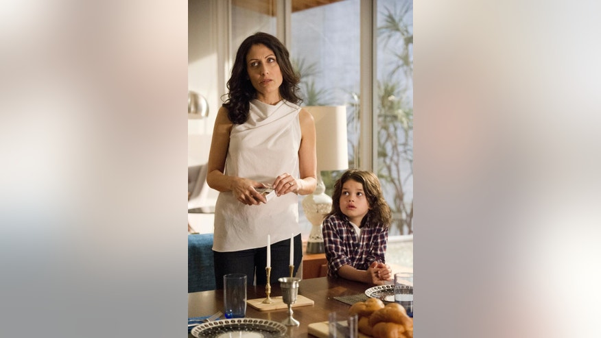 "This image released by Bravo shows Lisa Edelstein, left, and Dylan Schombing in a scene from ""Girlfriends' Guide to Divorce,"" Bravo's first original scripted series, premiering Dec. 2. (AP Photo/Bravo, Carole Segal)"