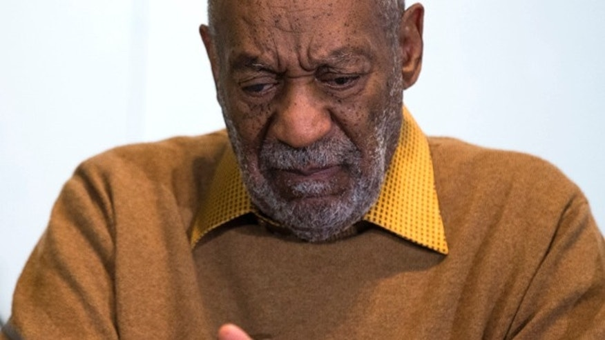 FILE - In this Nov. 6, 2014 file photo, entertainer Bill Cosby pauses during a news conference. (AP Photo/Evan Vucci, File)