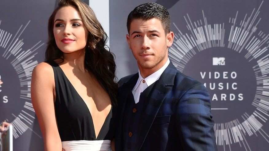Musician Nick Jonas and Olivia Culpo arrive at the 2014 MTV Music Video Awards in Inglewood, California August 24, 2014.
