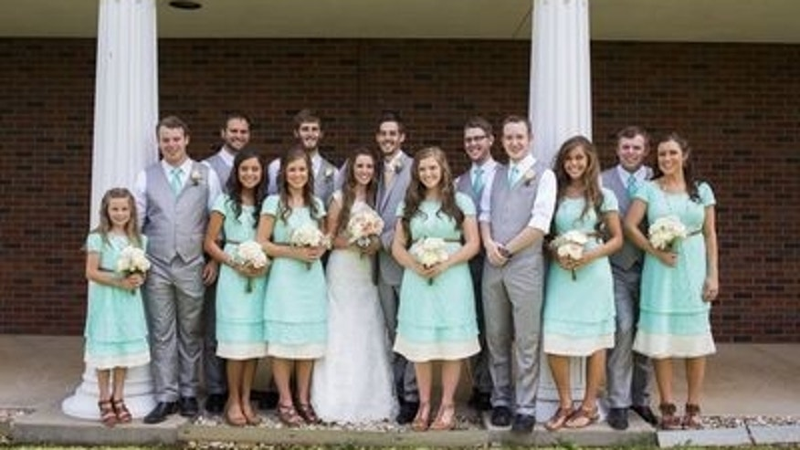 June 21, 2014. Jill Dillard, formerly Duggar, and Derick Dillard, both center, stand with their entire bridal party consisting of (LtoR) Johannah Duggar, Joseph Duggar, Madison McCalmon, Jinger Duggar, Jana Duggar, Daniel Dillard, Joy-Anna Duggar, Tony Dillard, Stephen Jones, Jessa Duggar, John-David Duggar, Anna Duggar prior to their wedding in Springdale, Arkansas