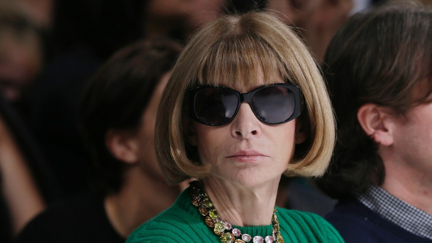 September 26, 2014. U.S. Vogue editor Anna Wintour attends the Belgian designer Raf Simons Spring/Summer 2015 women's ready-to-wear collection show for French fashion house Christian Dior during Paris Fashion Week.