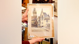 "In this photo taken Wednesday, Nov. 19, 2014, a picture titled  ""The Old City Hall"" that - as the auction house said - was painted by Adolf Hitler is displayed in an auction house in Nuremberg, Germany. The 100-year-old watercolor of Munich's city hall is expected to fetch at least 50,000 euros (US$ 60,000) at auction this weekend, not so much for its artistic value as for the signature in the bottom left corner: A. Hitler.  (AP Photo/Michael Probst)"