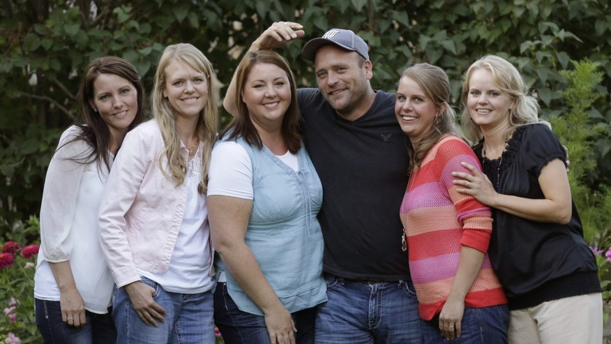Sept. 11, 2013. Brady Williams poses with his wives, from left to right, Paulie, Robyn, Rosemary, Nonie, and Rhonda, outside of their home in a polygamous community outside Salt Lake City.
