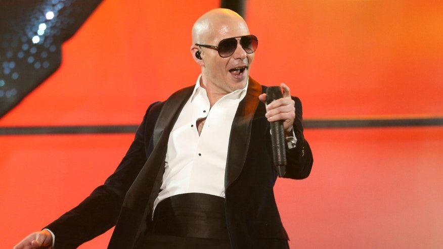 Pitbull performs at the 42nd annual American Music Awards at Nokia Theatre L.A. Live on Sunday, Nov. 23, 2014, in Los Angeles. (Photo by Matt Sayles/Invision/AP)