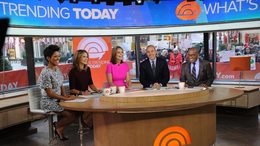 "In this Monday, Nov. 3, 2014 photo provided by NBC, from left, Tamron Hall, Natalie Morales, Savannah Guthrie, Matt Lauer, and Al Roker appear on the ""Today"" show, in New York. (AP Photo/NBC, Bryan Bedder)"