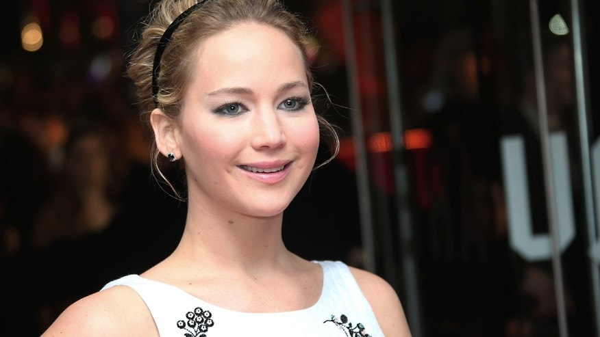 Actress Jennifer Lawrence poses for photographers upon arrival to the world premiere of the film The Hunger Games Mockingjay Part 1 in London, Monday, Nov. 10, 2014.
