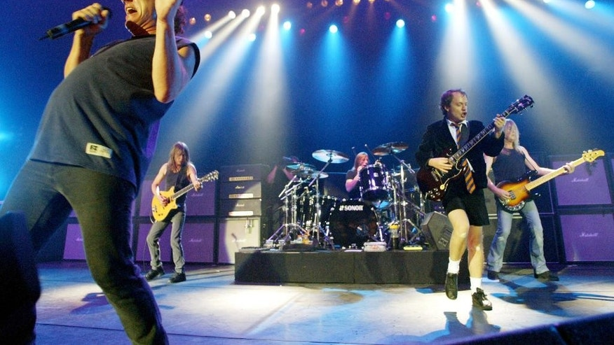 "FILE - This June 17, 2003 file photo shows British rock band AC/DC, from left, Brian Johnson, Malcolm Young, Phil Rudd, Angus Young, and Cliff Williams performing on stage during a concert in Munich, southern Germany. AC/DC will release a new album called ""Rock or Bust"" on Tuesday, Dec. 2, 2014. It is the Australian band's first release since 2008's ""Black Ice."" (AP Photo/Jan Pitman, File)"