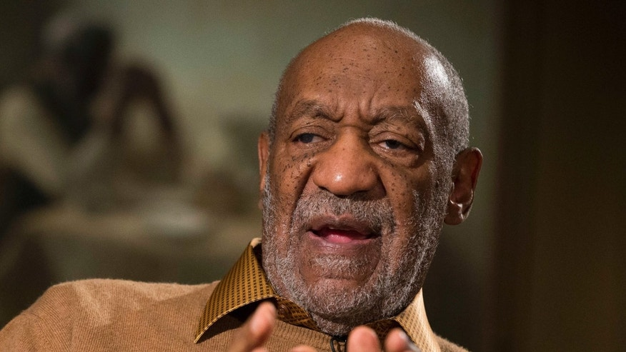 "Nov. 6, 2014. Bill Cosby gestures during an interview about the upcoming exhibit, ""Conversations: African and African-American Artworks in Dialogue,"" at the Smithsonian's National Museum of African Art, in Washington."