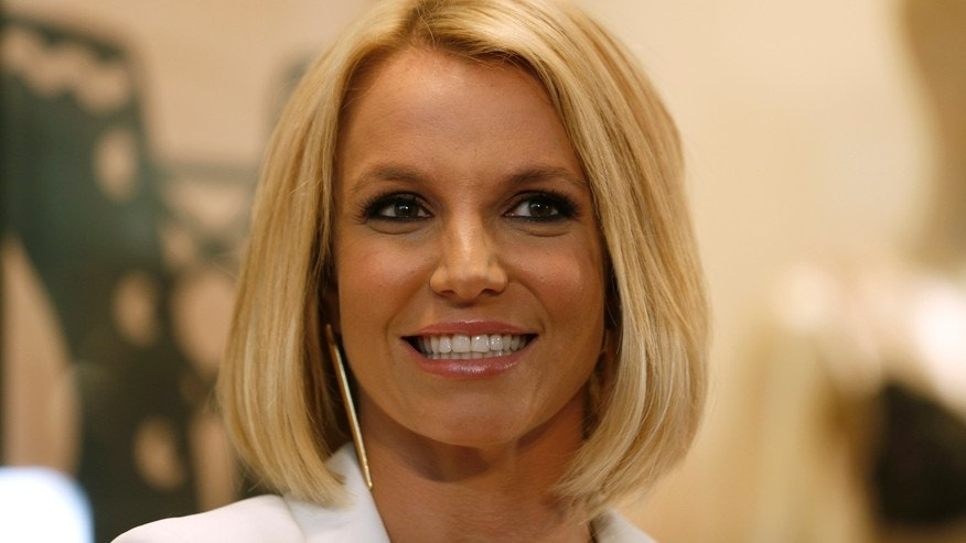 Singer Britney Spears smiles during the launch of her lingerie collection 'The Intimate Britney Spears Spring/Summer 2015', at a shopping mall in Oberhausen September 25, 2014.