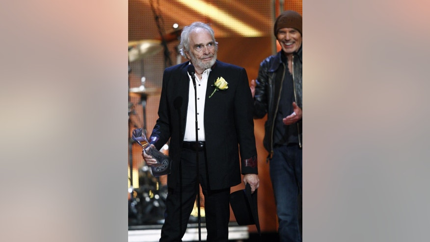 "Merle Haggard accepts the ""Artist of a Lifetime"" award during the CMT Artist of the Year Awards at the Schermerhorn Symphony Center on Tuesday, Dec. 2, 2014, in Nashville, Tenn. (Photo by Wade Payne/Invision/AP)"