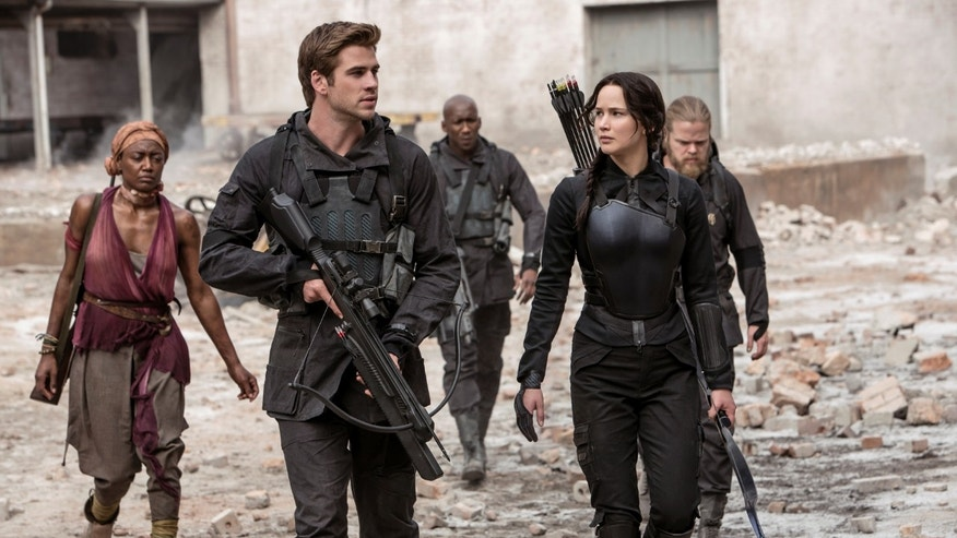 "Jennifer Lawrence portrays Katniss Everdeen, right, and Liam Hemsworth portrays Gale Hawthorne in a scene from ""The Hunger Games: Mockingjay Part 1."""