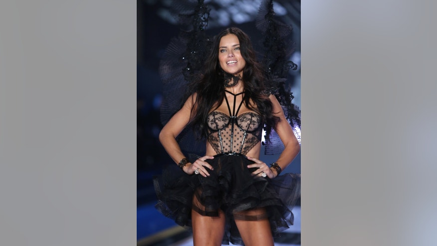 Model Adriana Lima displays a creation at the Victoria's Secret fashion show in London, Tuesday, Dec. 2, 2014. (Photo by Joel Ryan/Invision/AP)